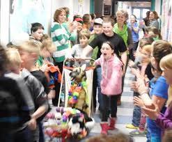 students howling after books at cape cod hill daily bulldog