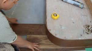 installing hardwood flooring on concrete around curved stair