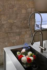 Modern Faucet Kitchen by Apartments Cushioned Tower Residence As Perfect Age Combination