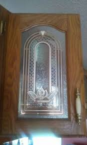 etched glass kitchen cabinet doors what else can be used instead of glass in kitchen cabinet