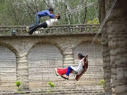 Nek Chand Rock Garden Youths On Swings Nek Chand Rock Garden Chandig Flickr