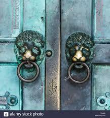 two metal lion door knockers on double doors amalfi campania