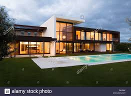 modern villa front elevation at dusk of modern villa in spain stock photo