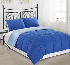 bedroom fascinating blue comforter with iron bed and wall art