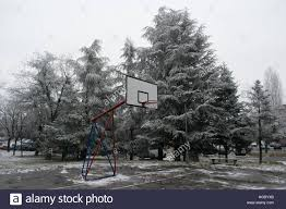 outdoor basketball court on the cold winter day with snow and ice