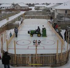 strange backyard shared homemade hockey rink john deere lawn