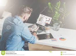 Office Table Back View Back View Young Bearded Businessman In Shirt Sits In Office At