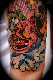 red hannya mask tattoo on calf tattooshunter com