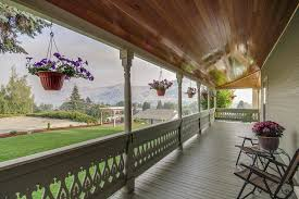 porch hanging flower baskets balcony victorian with green posts