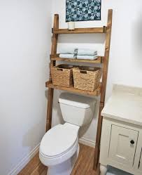 Storage Idea For Small Bathroom by Leaning Bathroom Ladder Over Toilet Shelf Knock Off Wood