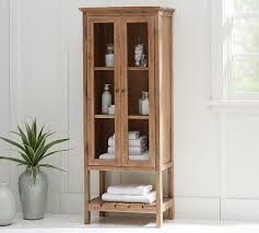 tall cabinet with glass doors rustic wood linen closet
