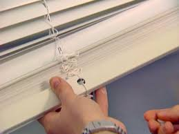 Putting Up Blinds In Window How To Install Window Blinds How Tos Diy