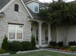 i designed arched columns on the front porch made of stucco u0026 a