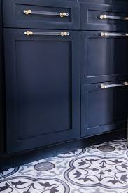 deep laundry room cabinets deep navy blue cabinets and pattern tile modern laundry room by