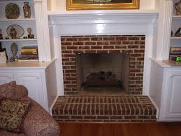 brick fireplace encased in shelving dream home pinterest