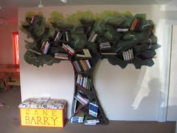 tree shaped of creative bookshelves with white wall paint