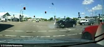 ran a red light camera dashcam captures dramatic moment car smashes into a traffic light
