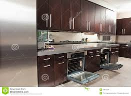 Kitchen Oven Cabinets by Commercial Kitchen With Open Oven And Cabinets Royalty Free Stock