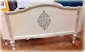 shizzle design antique bed with beautifully carved headboard and