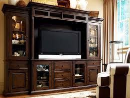 tv unit with glass doors large brown wooden cabinet with glass also wooden doors combined