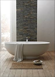 Designer Bath Rugs Endearing Design Ideas Using Oval White Free Standing Bathtubs And