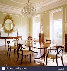 dining room with gilt mirror and chandelier in wickham house