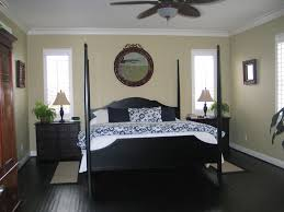 contemporary guest bedroom with ceiling fan u0026 hardwood floors in