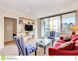 apartment living room interior with red sofa and chairs stock