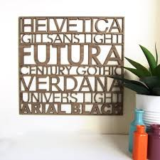 sans serif typography wood wall