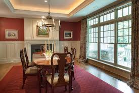 traditional dining room with wainscoting u0026 metal fireplace in