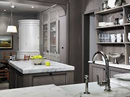 grey wash kitchen cabinets with marble counter tops