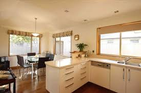 kitchen with islands kitchen gas range hood white wall cabinets l shaped kitchen with