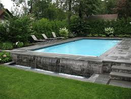 cottage style rectangular above ground swimming pool with stone