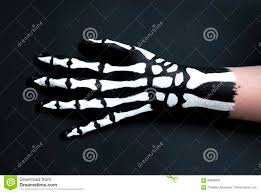 back of hand painted to look like bones for halloween stock photo