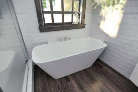 aquatica arabella l wht large corner solid surface bathtub