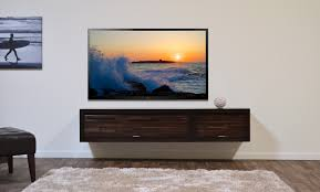 wooden floating tv console with two doors in different size of
