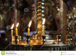 candles light on chandelier in ancient orthodox church stock photo