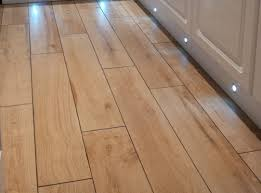 wood effect ceramic tiles for the cafe floor hard wearing and