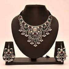 indian metal necklace images Buy avni 39 s black metal necklace and earrings with emeralds and jpg