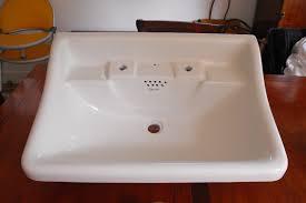 repairing a smashed antique wash hand basin bath resurfacing