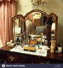 antique dressing table with mirror close up of a vintage dressing table with triple mirror stock photo