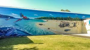 krimsone street art murals beach scene