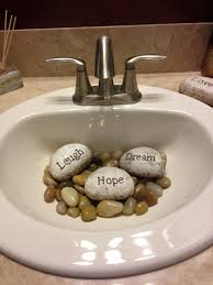 river rock bathroom ideas neat way to cover an unsightly drain fill a guest sink partially