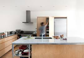 la shed architecture plywood marble stainless steel kitchen