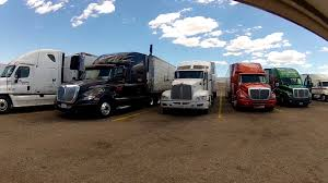 semi trailer truck big rig semi tractor trailer trucks in truck stop parking lot 1