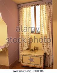 patterned curtains on window above butler u0027s sink in cream country