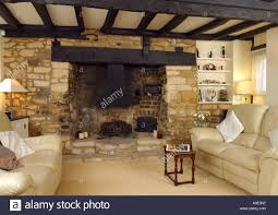 sitting room dark oak beamed with large fireplace stock photo