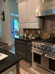 is it better to refinish or replace kitchen cabinets is refinishing kitchen cabinet a better idea than replacing