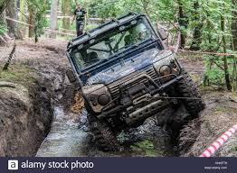 During Challenge Blue 4x4 Land Rover Defender 90 During Muddy 4x4 Road