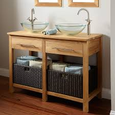 brown wooden bathroom double vanity having black rattan basket
